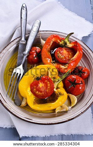 Peppers and tomatoes, roasted in oil, with garlic and dill