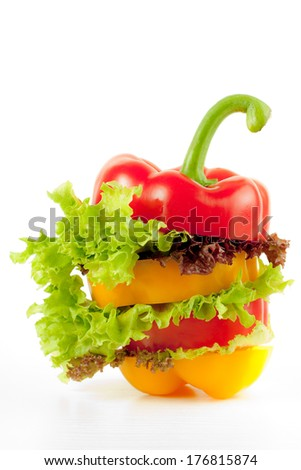 Peppers mixed with salad on white