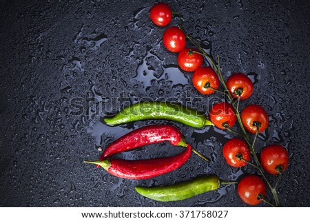 peppers on black slate