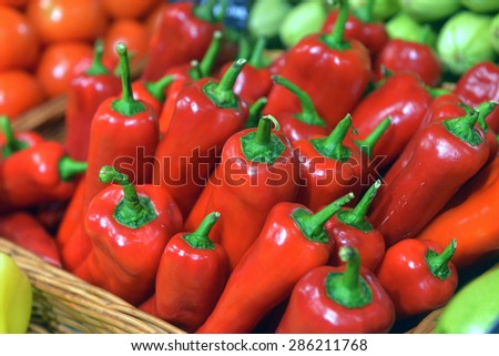 peppers on display in a supermarket - stock photo