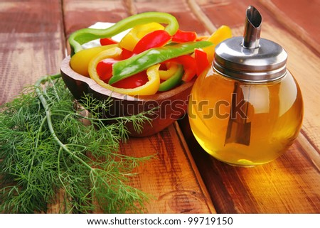 peppers sliced for salad on wooden table - stock photo