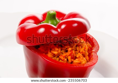 Peppers stuffed with Curried rice and selected sharpness on white background
