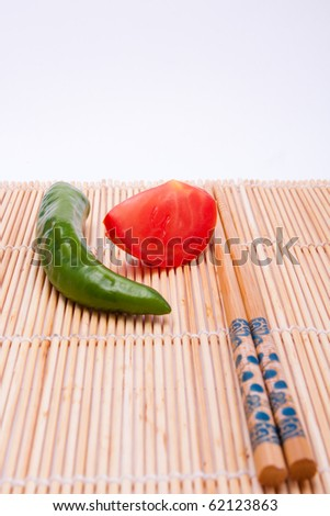 Peppers, tomatoes, sticks - stock photo