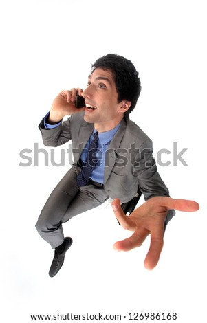 Peppy businessman talking on his mobile phone - stock photo