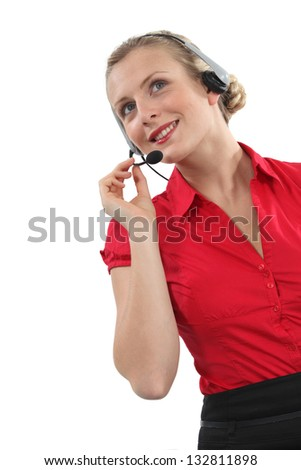 Peppy woman wearing a headset - stock photo