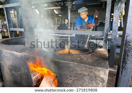 PERAK, MALAYSIA-APRIL 22: Aun Tong mill traditional coffeemaker worker at Taiping town on April 22, 2015 in Perak, Malaysia. This product is for export and very popular around Taping town. - stock photo