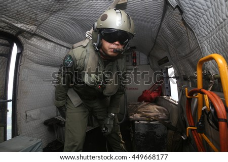 Perak, Malaysia - 2 June 2016: Military personnel seen inside Sikorsky S-61A-4 helicopter used by Royal Malaysian Army, also called Nuri.