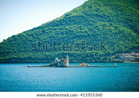 Perast Montenegro. island church in perast kotor bay montenegro. Sea view, Monastery on the island in Perast, Montenegro  - stock photo