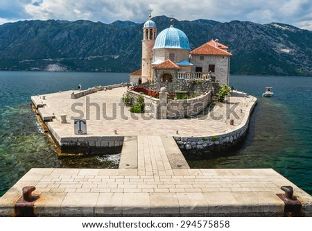 PERAST, MONTENEGROO, Berth of Our Lady on the Rock island and Church in Perast on shore of Boka Kotor bay (Boka Kotorska) - stock photo