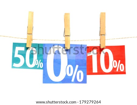 Percent adverts in clothes pegs - stock photo