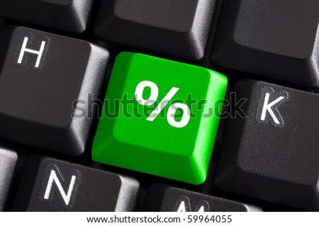 percent sign on computer keyboard showing discount concept