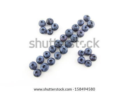Percentage concept made of fresh blueberries isolated on white - stock photo