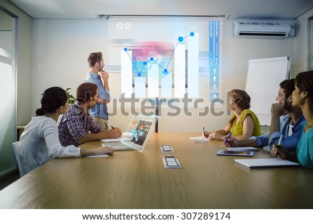 Percentages graphical representation against attentive business team following a presentation - stock photo