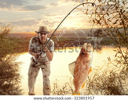 Perch. Man fishing in the river at sunset