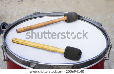Percussion instrument - Old Drum - focus on drumsticks - stock photo