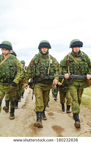 PEREVALNE, UKRAINE - MARCH 5: Russian soldiers marching on March 5, 2014 in Perevalne, Crimea, Ukraine. On February 28, 2014 Russian military forces invaded Crimea peninsula.