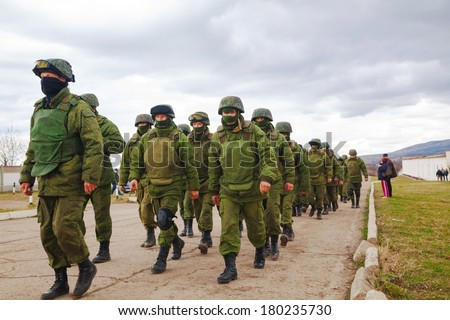 PEREVALNE, UKRAINE - MARCH 5: Russian soldiers marching on March 5, 2014 in Perevalne, Crimea, Ukraine. On February 28, 2014 Russian military forces invaded Crimea peninsula. - stock photo