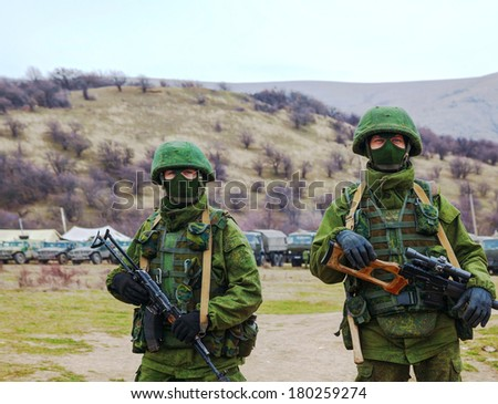 PEREVALNE, UKRAINE - MARCH 4: Russian soldiers on March 4, 2014 in Perevalne, Crimea, Ukraine. On February 28, 2014 Russian military forces invaded Crimea peninsula. - stock photo