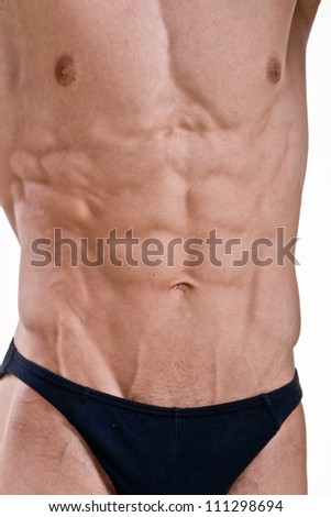 Perfect athletic male body isolated on white background