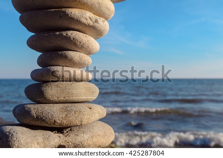 Perfect balance of pebbles on the seashore