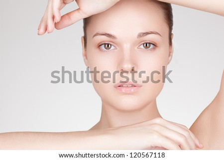 perfect beauty woman closeup portrait with hands  over white - stock photo