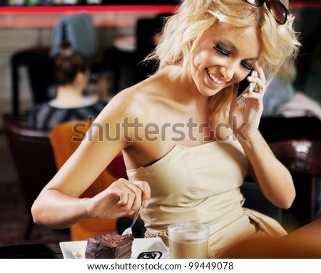Perfect blonde beauty calling someone on a lunch break