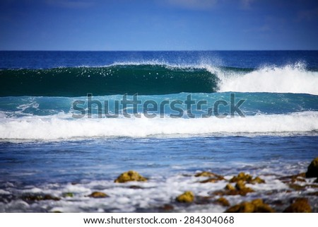 perfect blue wave in the sea water and blue sky - stock photo