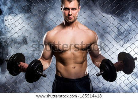 Perfect body man is showing his perfect body - stock photo