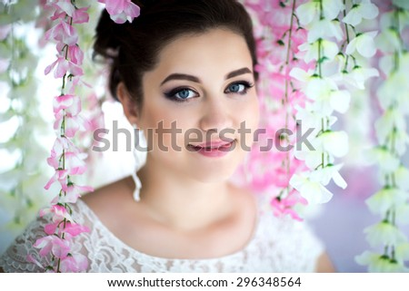 Perfect bride dreaming. Beautiful woman professional photo session, luxury wedding style, make-up & hairdress design, lace wedding dress, elegant bridal veil & florist bouquet, wife of millionaire  - stock photo