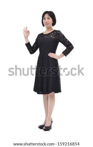 Perfect - business woman showing OK hand sign smiling happy.