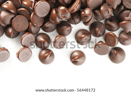 Perfect chocolate chips isolated on white background. Excellent border design element.