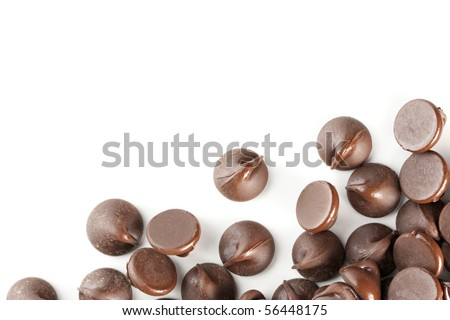 Perfect chocolate chips isolated on white background. Excellent border design element. - stock photo