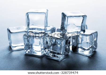 Perfect clear ice cubes on grey background - stock photo