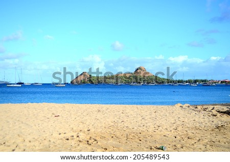 perfect day deep blue beach water and island scene