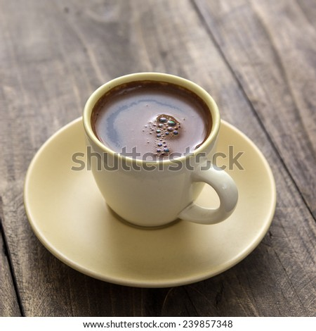 Perfect delicious Greek  coffee served in a  cup on wooden table - stock photo