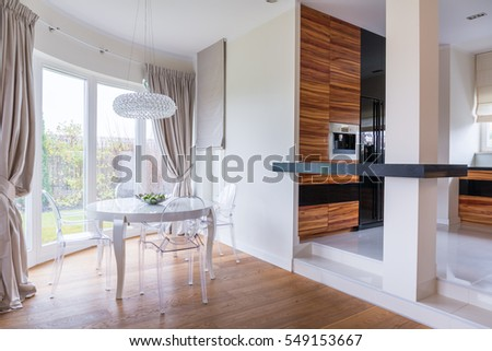 Perfect dining area with view of a kitchen