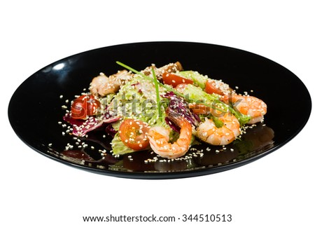 perfect dish with shrimps on a black plate. seafood. Isolated  white background