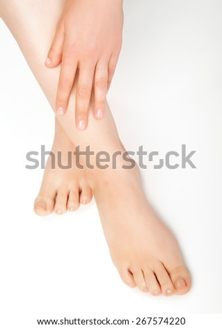 perfect feet of a young woman - stock photo