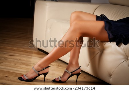 Perfect female legs wearing high heelsheels. Feeling elegant underneath it all - stock photo