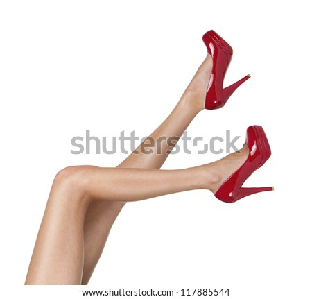 Perfect female legs with red high heels isolated on white background - stock photo