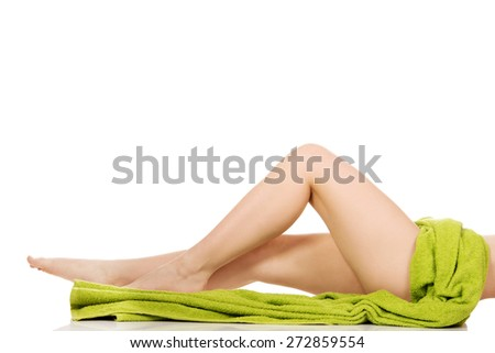 Perfect female slim legs wrapped in towel. - stock photo