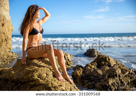 Perfect figure toned thin athletic body shape physique model bikini girl woman abs waist muscular looking out - stock photo