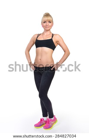 Perfect fit middle-age woman posing in studio - stock photo