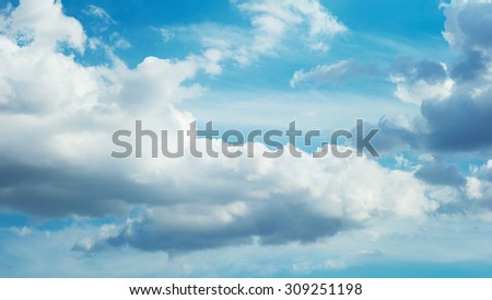 Perfect fluffy clouds in blue summer sky. Daydream, imagination, spiritual impression. Tranquil skylight. Freedom. We a free as a summertime clouds! - stock photo