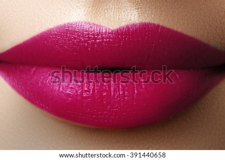 Perfect fuchsia lips. Sexy girl mouth close up. Beauty young woman smile. Fuchsia plump full Lips. Lips augmentation. Close up detail. Bright full lips - stock photo