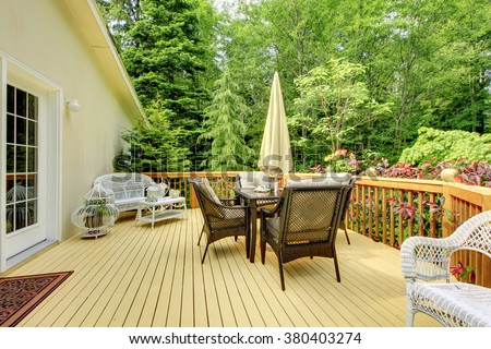 Perfect furnished deck with nice scenery. - stock photo