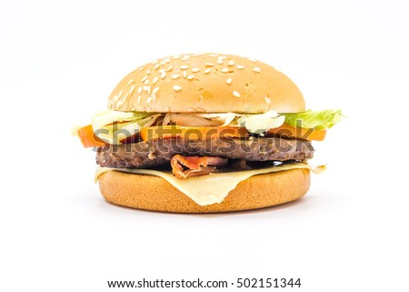 Perfect hamburger classic burger american cheeseburger with cheese,bacon, tomato and lettuce isolated on a white background.