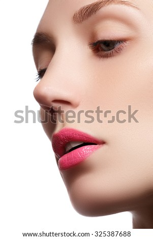 Perfect lips. Professional Make-up. Lipgloss. Closeup portrait of beautiful girl. Caucasian young woman model with bright makeup with perfect clean skin with colorful pink lips and lipstick - stock photo