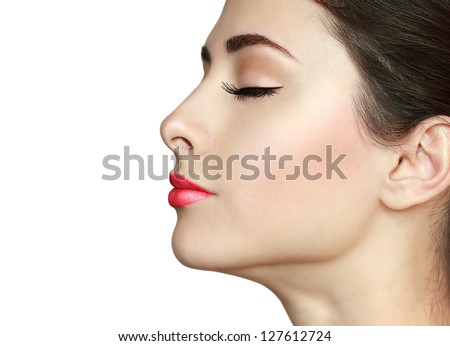 Perfect makeup. Beauty girl face profile with closed eyes and long lashes isolated on white background - stock photo