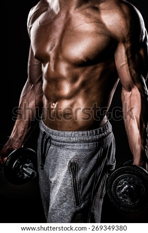Perfect male sportsman with weights - stock photo